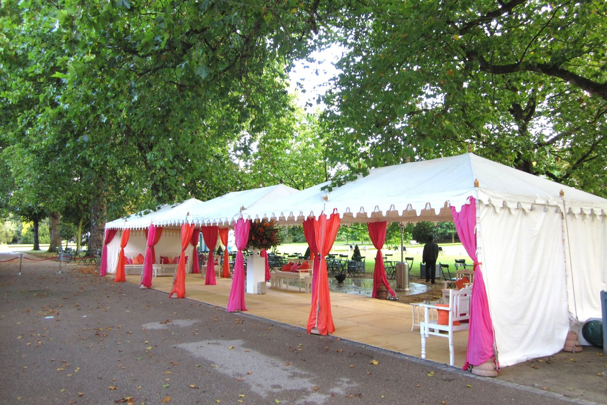 A triple metal frame Raj Tent in Battersea Park, London