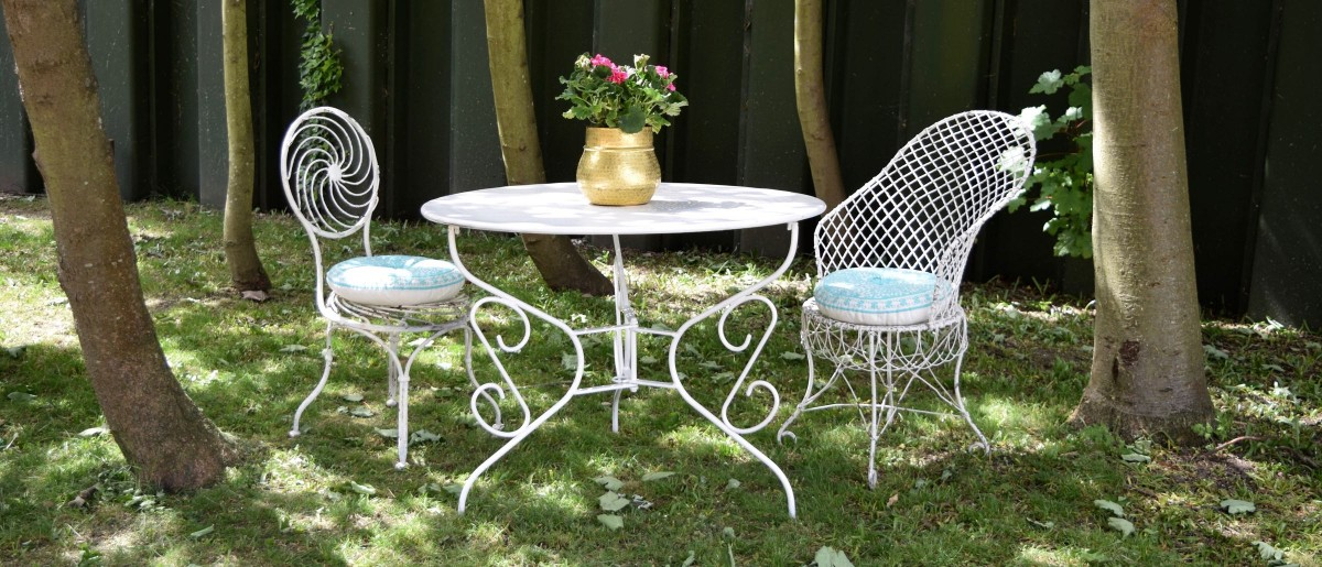 2 white metal regency garden chairs and table