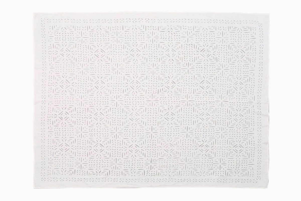 White cotton cut out bedspread geometric design