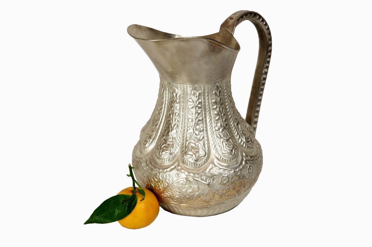 Embossed metal jug