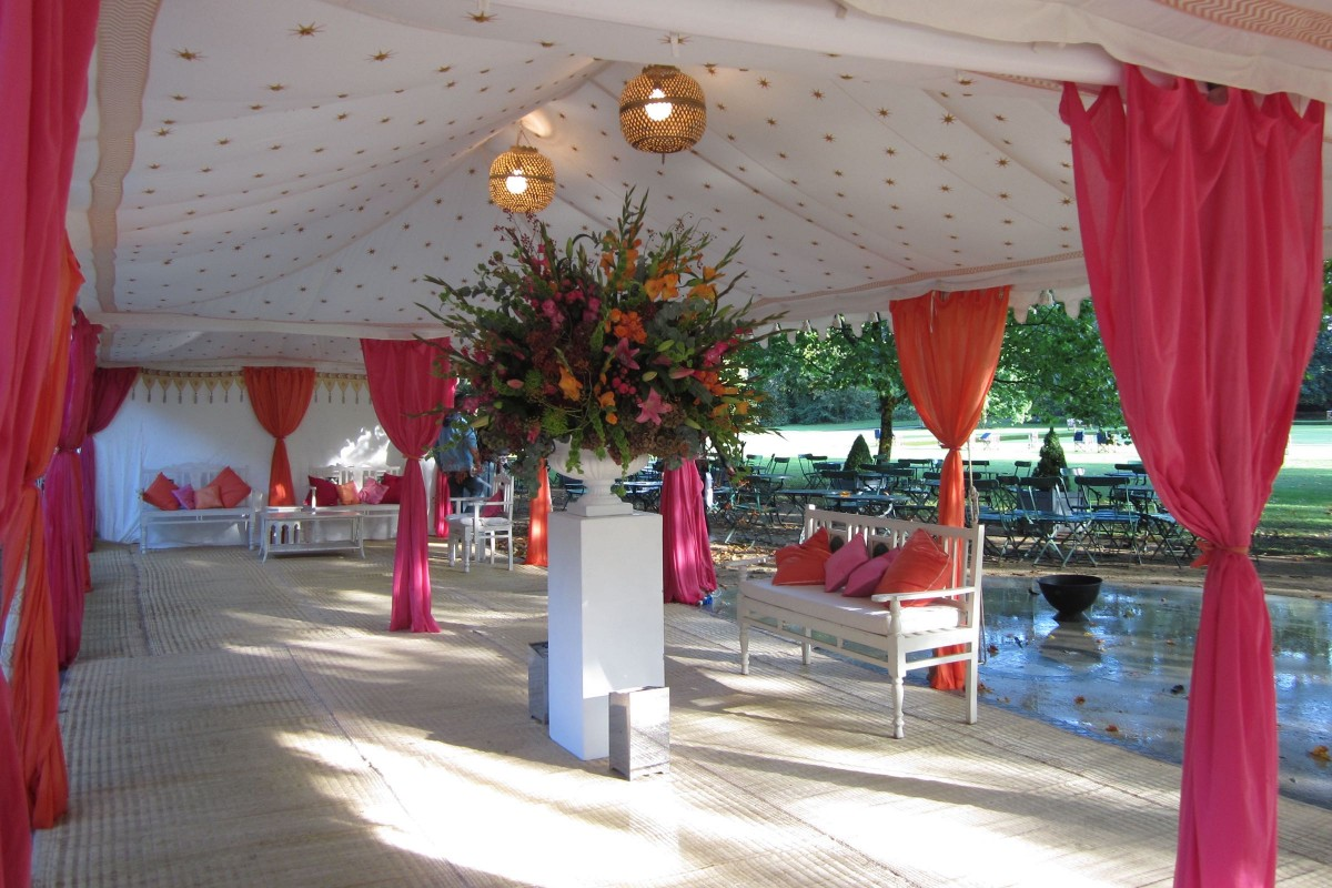 Interior of a triple metal frame Raj Tent in Battersea Park, London