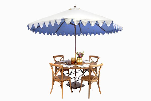 Celeste blue sunshade with round bistro table and cross back chairs