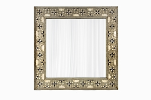 A mirror set in an old Indian metal work frame with bone inlay