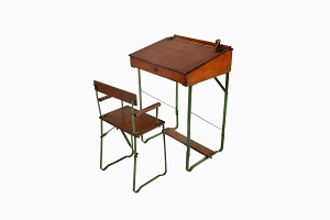 A vintage childs desk and chair