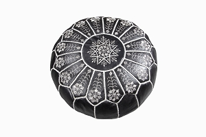 Black leather pouffe with white embroidery