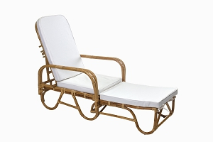 Cane sun lounger with cream cushions