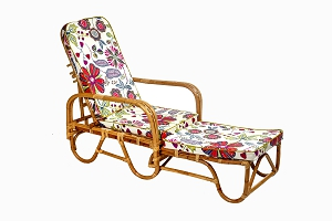 Cane sun lounger with tropical flower cushions
