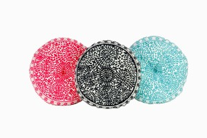 Coral, black and turquoise embroidered round cushions