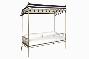 Palm Springs daybed gold with black and white striped and tasseled canopy
