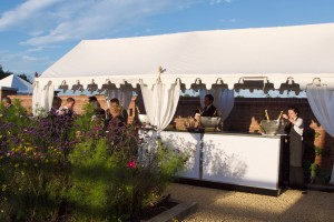 A Long Pergola used as a Champagne bar at Chewton Glen Hotel