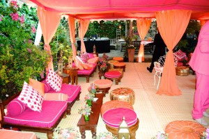 Orange and pink double Metal Frame Raj Tent in a London garden