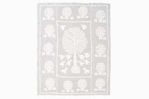 White cotton cut out bedspread tree of life design