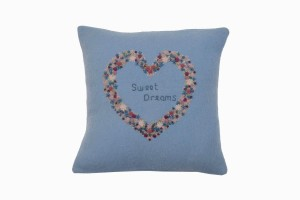 Blue wool cushion with embroidered heart