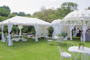 A metal frame Raj Tent at a garden party in Southern England